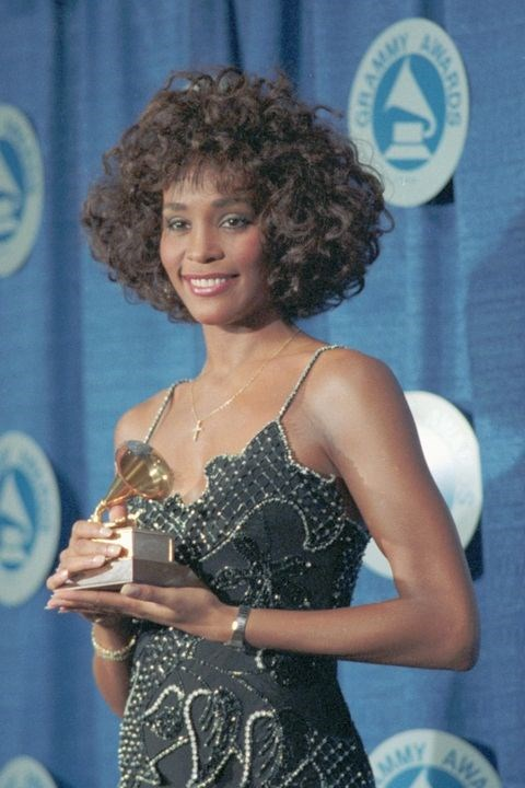 **1988: Curly bob** <br><br> Whitney Houston's bob is almost as big and powerful as her vocal range (almost!).