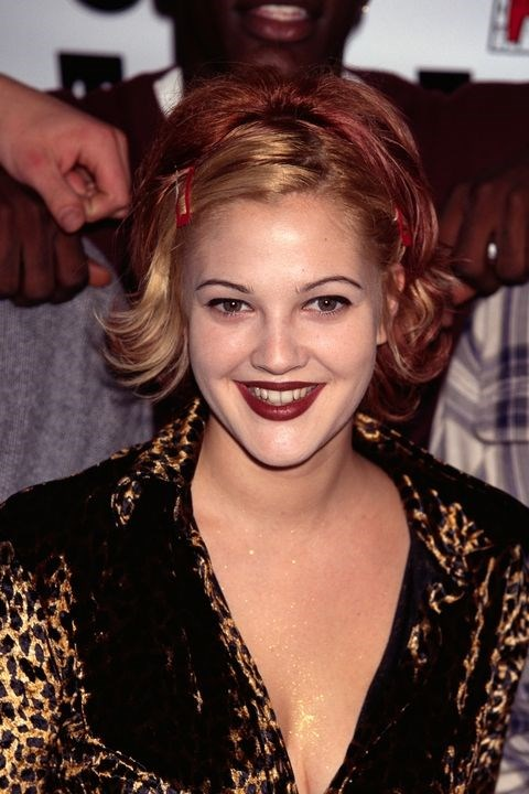 **1994: Side part with clips) <br><br> Drew Barrymore's side part/hair clip combo screams '90s. Bonus points for the roll-on body glitter!