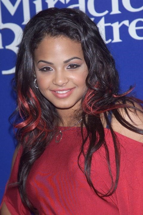 **2002: Coloured extensions** <br><br> Pick a colour, any colour, then pop in a few scattered clip-ins. Or be extra and match them to your outfit like Christina Milian.