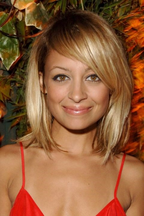 **2005: Side-swept bangs** <br><br> Nicole Richie helped usher in the year of the side-swept bang. The goal? To *slightly* cover up one of your eyes.