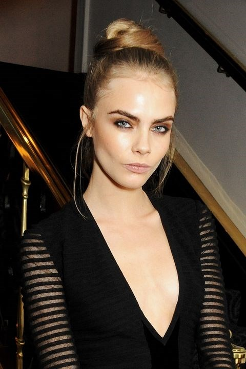 **2012: Top knots** <br><br> Cara Delevingne rocked the hottest style of 2012, which was essentially a dressed-up messy bun.