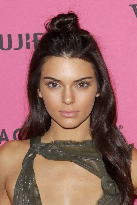 **2015: Half-up bun** <br><br> Like the top knot, a half-up bun, like Kendall Jenner's, is equal parts effortless and chic.