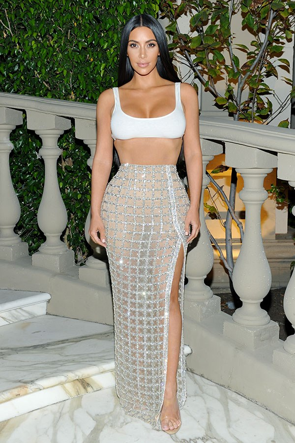 Kim Kardashian proves she's fkn FEARLESS in the fashion department, stepping out wearing a workout crop top and a dazzling sequin skirt like it ain't no thang.