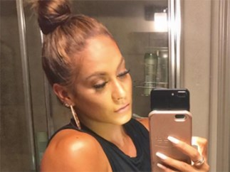 We're 99% sure this bodybuilder is Jennifer Lopez's secret twin