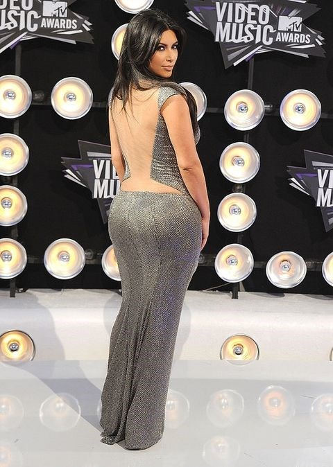 **KIM KARDASHIAN WEST: 2011** <br><br> Pre-Kanye Kim was a lot more bling than high-fashion. This low-cut, metallic, floor-length gown with a sheer back and matching cuff is very true to form.  <br><br> Beauty wise, take note of the very smokey eye and lack of contouring, proving that, just like every other style icon, she's certainly had a journey.