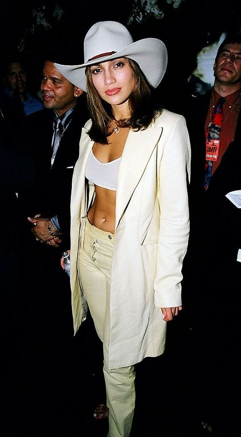 **JENNIFER LOPEZ: 1998** <br><br> The widely-held belief that J-Lo simply *does not age* is further proven by this photo of her attending her first VMAs in 1998, when she was 29.  <br><br> We are here for the all-white getup, hat included, and reckon she was probably taking style tips from her boyfriend at the time: Puff Daddy.