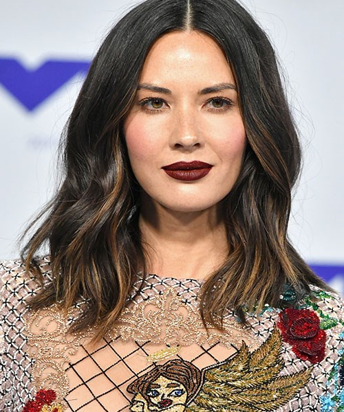 **Who:** Olivia Munn <br><br> **Why we love the look:** Actress Olivia Munn's entire hair and makeup look is a lesson to us all in how to wear dark red lipstick.
