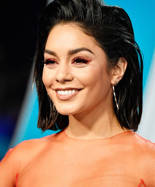 **Who:** Vanessa Hudgens <br><br> **Why we love the look:** This? Oh, this is just Vanessa Hudgens at the VMAs wearing *red winged liner*!(!!) Who knew red eyeliner could be so chic?