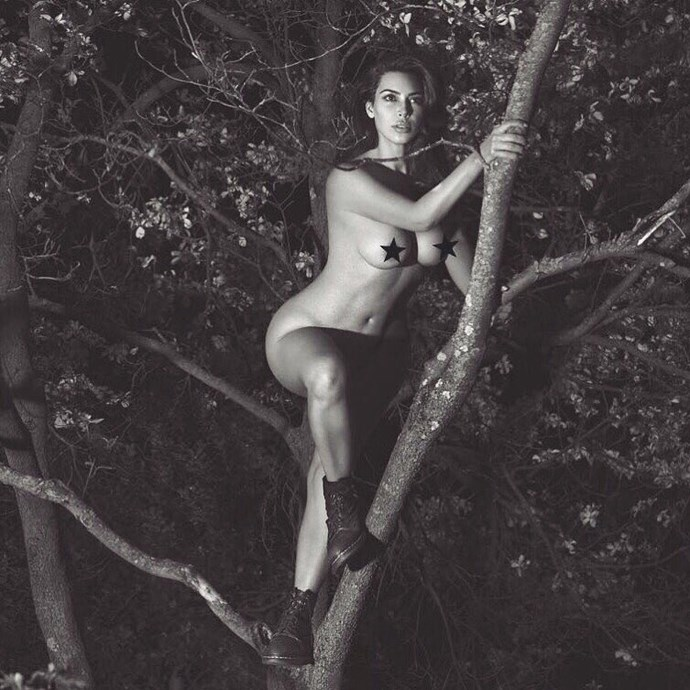 Kim decided to climb a tree wearing nothing... but boots. Hey, at least she had appropriate footwear on. (The photo was for a new book by photographers Mert and Marcus, but STILL.)