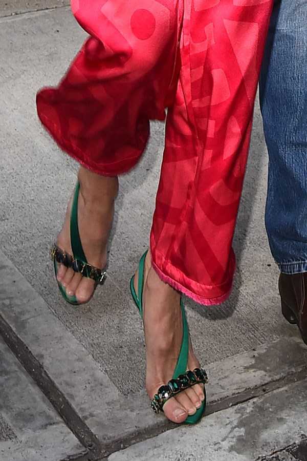 So she went for these emerald green beauties with a row of ginormous jewels because of course.