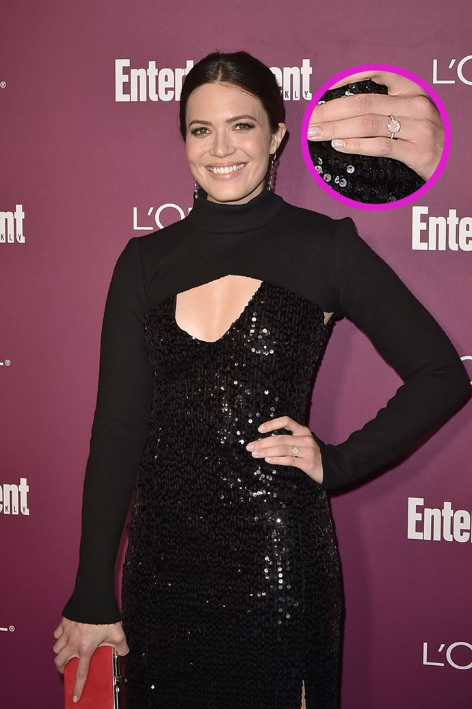 Mandy Moore just made her first red carpet appearance since getting engaged to Taylor Goldsmith and OMFG the ring is actually amaze. The round solitaire diamond is surrounded by a ring of pave diamonds and we're dying RN.