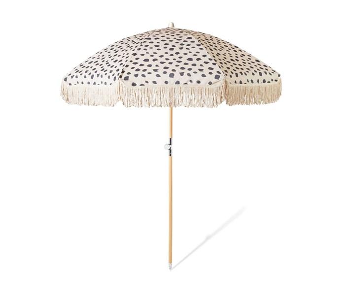 "Beach Umbrella, $239, at [Sunday Supply Co](https://sundaysupply.co/collections/beach-umbrellas/products/black-sands-beach-umbrella|target=""_blank""|rel=""nofollow"")"