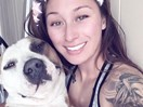 Woman flees fire on bike with 31kg dog in her duffel bag
