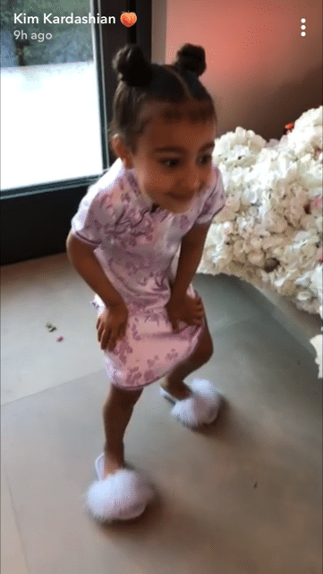 And, of course, lil' North was there to celebrate in a matching dress and the fluffiest shoes you've ever seen.