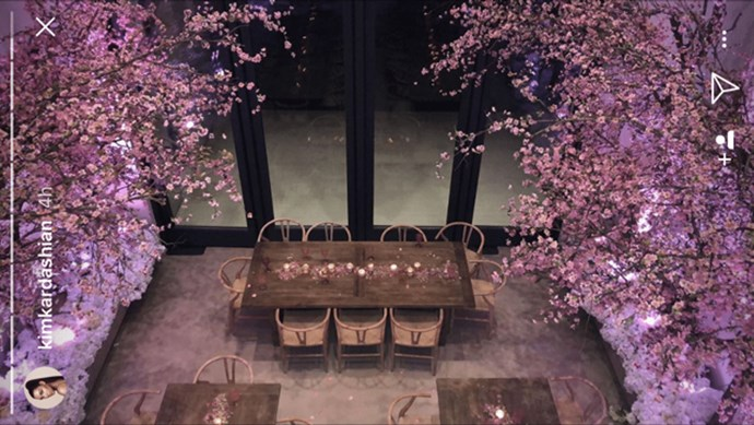 The location was like a floral pink wonderland, with tables set between cascading walls of Cherry Blossom branches.