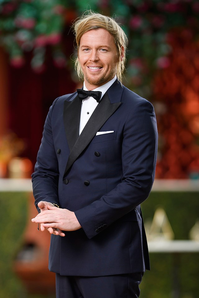 "**Samual Cochrane**, the voiceover artist from Sophie Monk's season of *The Bachelorette* in 2017, best known for scoring the double delight rose and making comments about Sophie's ""cans"" on the photo shoot group date. He has been spotted arriving in Fiji ahead of filming."