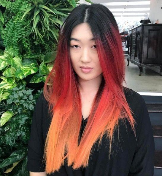 """**Ombre Hair: Fiery strands** <br><br> Be bold, and take on a statement shade (or two). This style blends from the black to red to orange... *Ah-mazing*, huh? <br><br> (via [@thefoxandthehair](https://www.instagram.com/thefoxandthehair/?hl=en