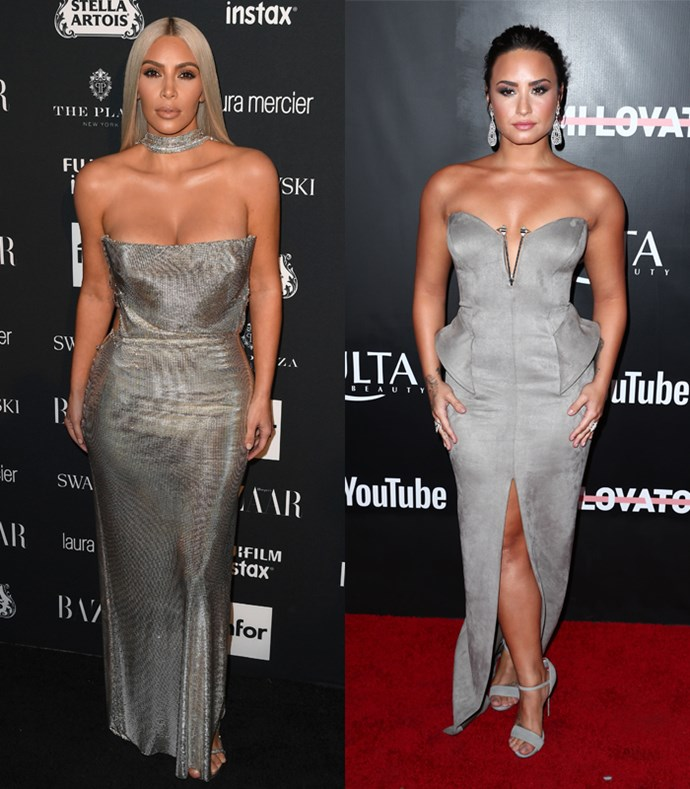 Here's Demi wearing a sexy silver strapless gowns that just oozes Kardashian sex appeal.