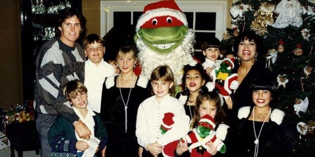 ...Meanwhile Kris posed up a storm with her new family (courtesy of Bruce Jenner) and, what appears to be, a giant ninja turtle Santa Claus. P.S. Spot a mini Brody Jenner before he grew up and broke multiple girls' hearts on *The Hills*.