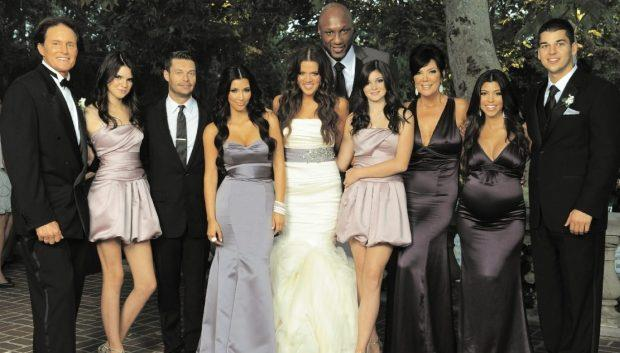 This year's Christmas card came in the form of Khloé's wedding photos Meaning old mate Lamar Odom was the first 'plus one' to feature in a Kardashian Christmas card - even though he barely fit in the damn frame.