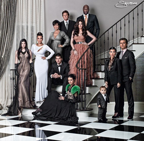 Glammer than ever, the whole squad (plus Lamar, Scott and baby Mason) brought the drama on the staircase of Momma Kris' home. Don't all regular families whack on a ball down and drape themselves across the stairs?