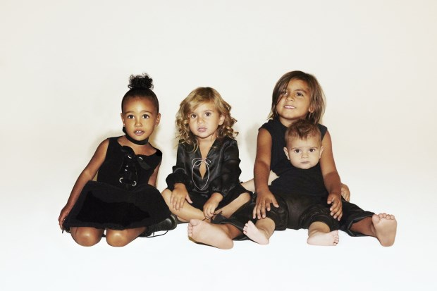 This Kardashian Christmas essentially tried not to fall subject to speculative headlines - as around the time Lamar was dealing with his drug issue, Scott was partying a hell of a lot, and Bruce had transformed into Caitlyn. Plus ones were just a little too complicated to feature (or not feature), so they avoided all by just sharing an adorable shot of the grandkids. Mason, Penelope, North and Reign sat together to ring in Christmas - making this, potentially, the most simple Kardashian Christmas card of them all.