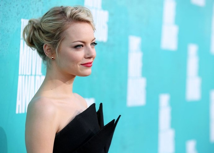 **Emma Stone's classic twisted updo** <br><br> Some days your hair just gets in the way (aka, every day of summer), so roll your locks up into a twisted updo and pin into place.