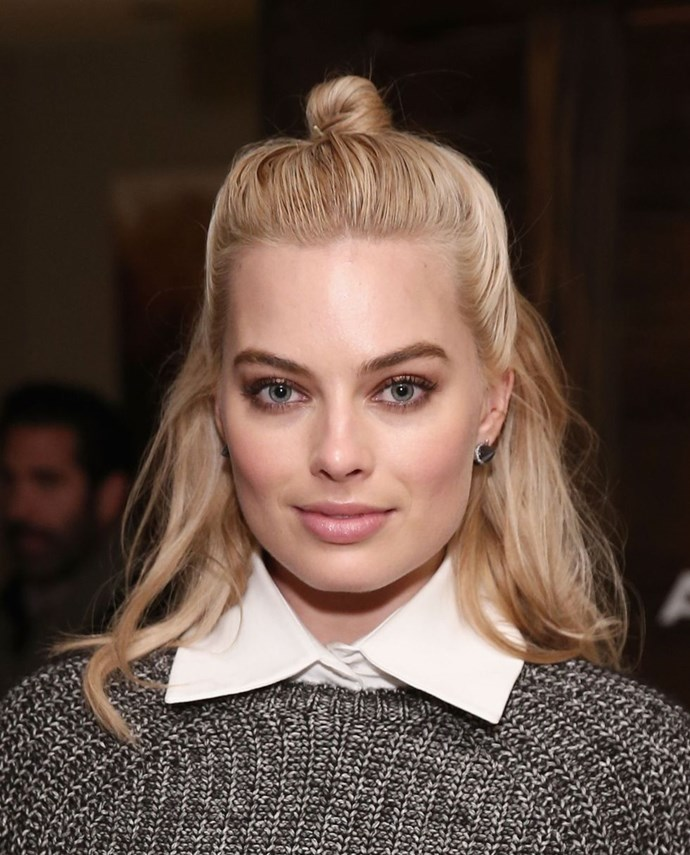 **Margot Robbie's half-up bun** <br><br> If you want to disguise greasy locks but can't bear wearing your hair up, the 'hun' (half-up bun) is for you. Section off the top half of your locks and twist the lengths into a knot before pinning in place, give the rest of your hair a spritz with dry shampoo and you're good to go.