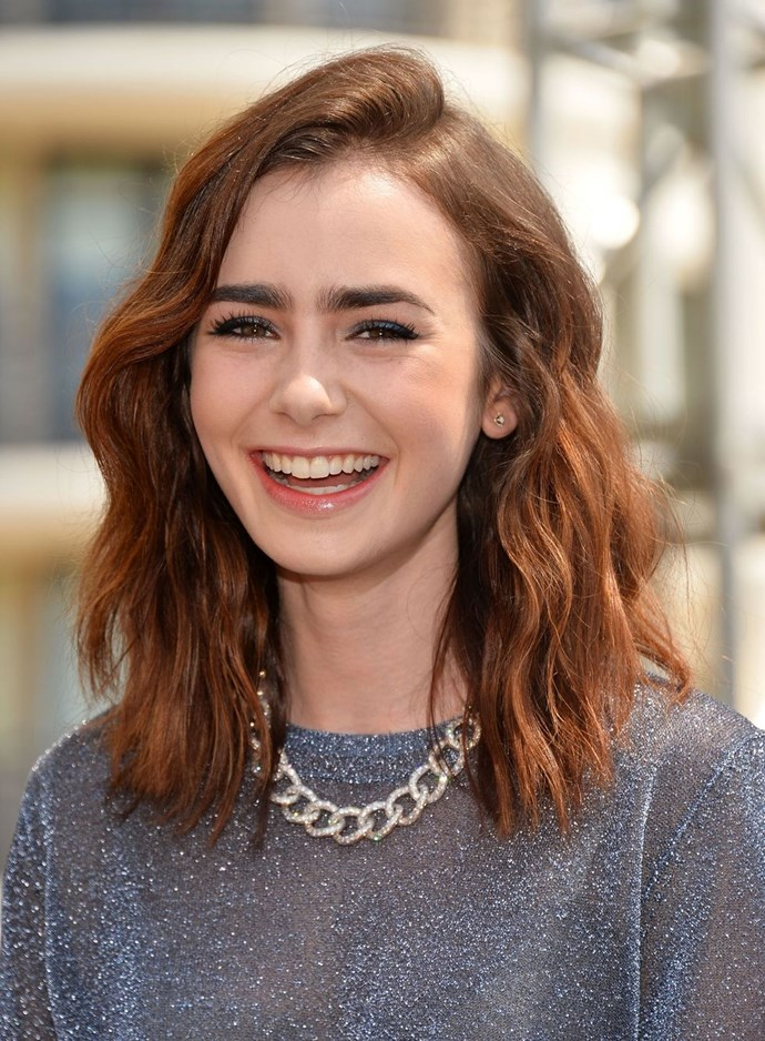 **Lily Collins' mermaid waves** <br><br> Switch the ringlets for mermaid-esque waves like Lily Collins. Use your straightener to bend the hair back and forth and create an 'S' shape, then run your fingers through the lengths to separate the strands and create a loose, dishevelled finish.