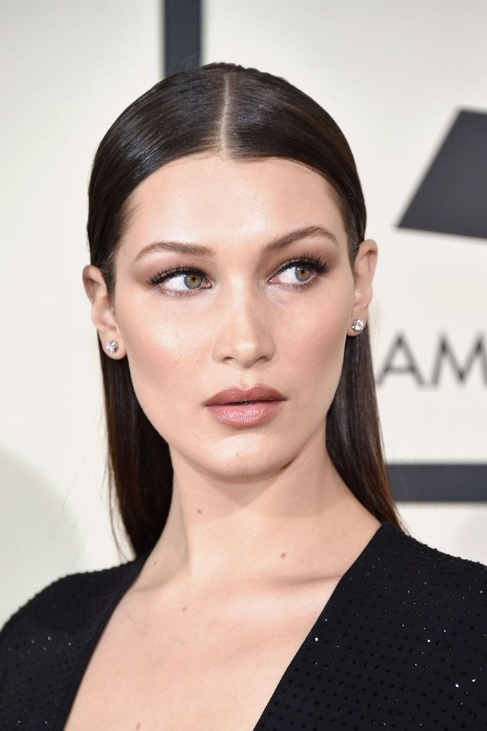 **Bella Hadid's slicked down centre-parting** <br><br> A polished centre-parting makes for a chic but simple hairstyle. Use a high-shine hairspray and a fine-tooth comb to achieve this look.