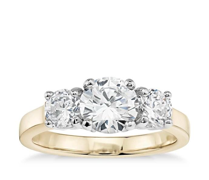 "Classic Three-Stone Diamond Engagement Ring, $810 from [Blue Nile](https://www.bluenile.com/au/build-your-own-three-stone-ring/classic-three-stone-engagement-ring-yellow-gold_58240?elem=img&track=product&vtype=sample|target=""_blank"")."
