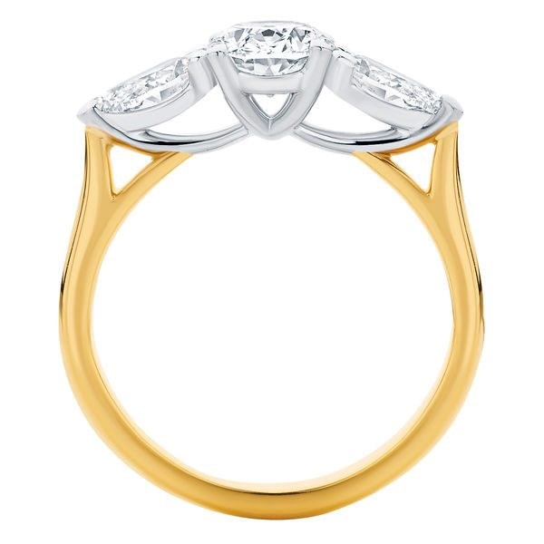 "Delta Trio 18ct Yellow Gold Ring, $2,280 from [Larsen Jewellery](https://www.larsenjewellery.com.au/engagement-rings/oval-cut/delta-trio-yellow-gold|target=""_blank"")."