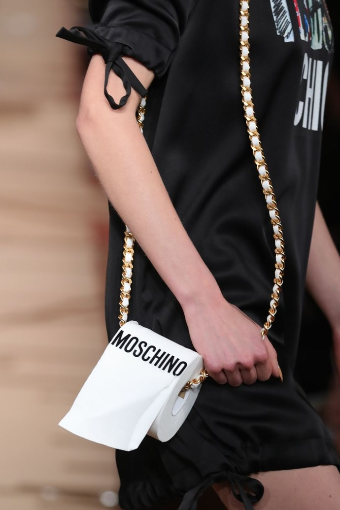 **Moschino's Toilet Paper Purse** <br><br> The theme for Moschino's autumn winter '17 show in February was literally garbage. Models walked down the runway in cardboard box get-ups, feather-duster headpieces, and toilet-paper purses. Fashion!
