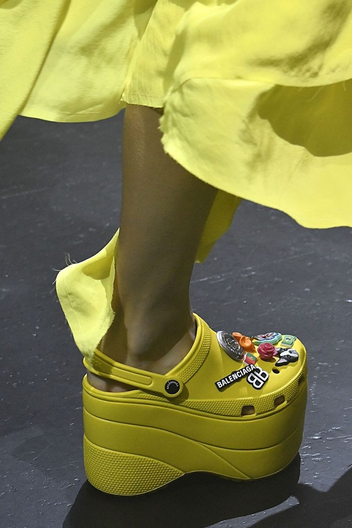 **Balenciaga's Platform Crocs** <br><br> If someone told me a couple of years ago that Crocs would, one day, be considered high fashion, I would've laughed. But here we are! Christopher Kane included gem-adorned versions in his 2016 show, and then, in September, Balenciaga debuted its own take, which involved sky-high platforms.