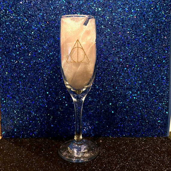 """Harry Potter Inspired Deathly Hallowed Champagne Flute, $16.51 from [Etsy](https://www.etsy.com/au/listing/573258365/harry-potter-inspired-deathly-hallowed