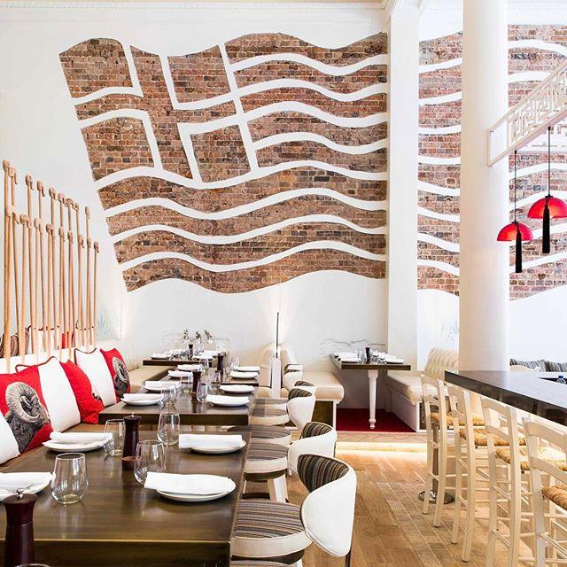 "**1821** <br><br> The Greek food at this restaurant is divine - you *have* to try the pork belly baklava - but the décor is equally stunning! One wall has a giant Greek flag brick feature, and there are two horses that stand over the front doors. Opa! <br><br> Image: [@1821restaurant](https://www.instagram.com/p/BSCfjeYAi6C/|target=""_blank"")"