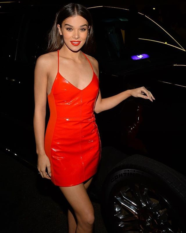 Hailee Steinfeld stepped out in a patent leather red mini dress for her birthday.