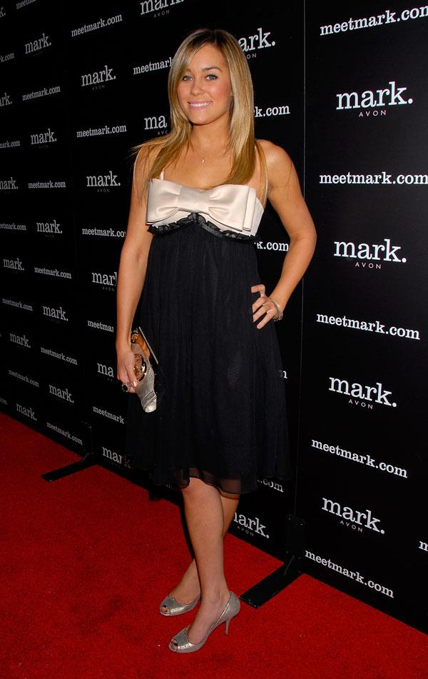 Last but not least is Lauren Conrad, who wore this very 2000s bow dress for her party with her mates from *The Hills*.