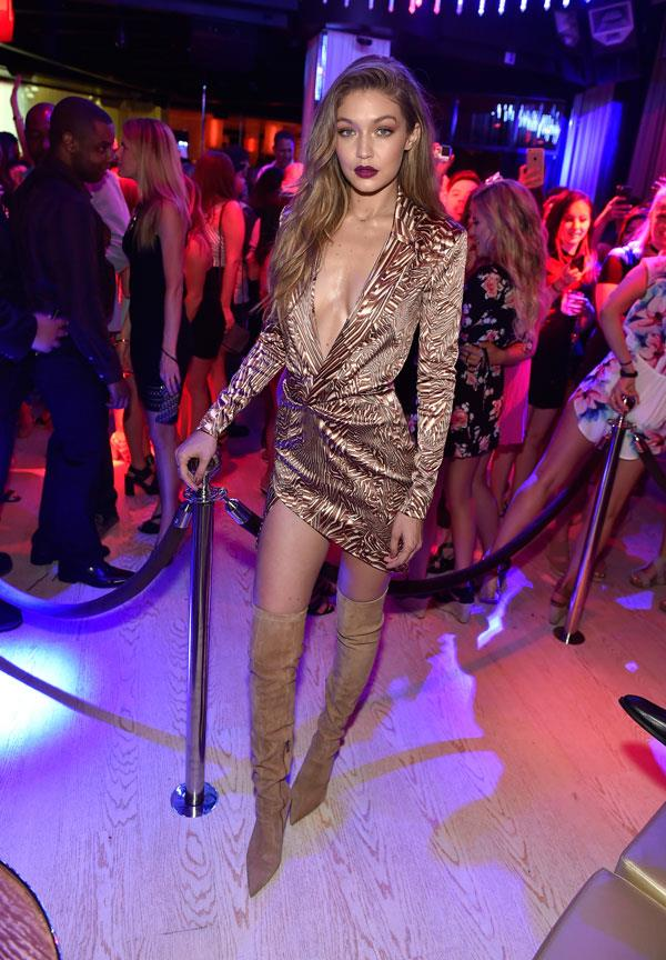 Gigi Hadid wore a plunging mini and thigh-high suede boots to the club.