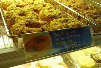 **Dry Pork and Seaweed Doughnuts:** Though this may seem like an odd combo dreamt up in some stoner's kitchen at 3am, this is actually a legit flavour served at Dunkin' Donuts in Singapore!