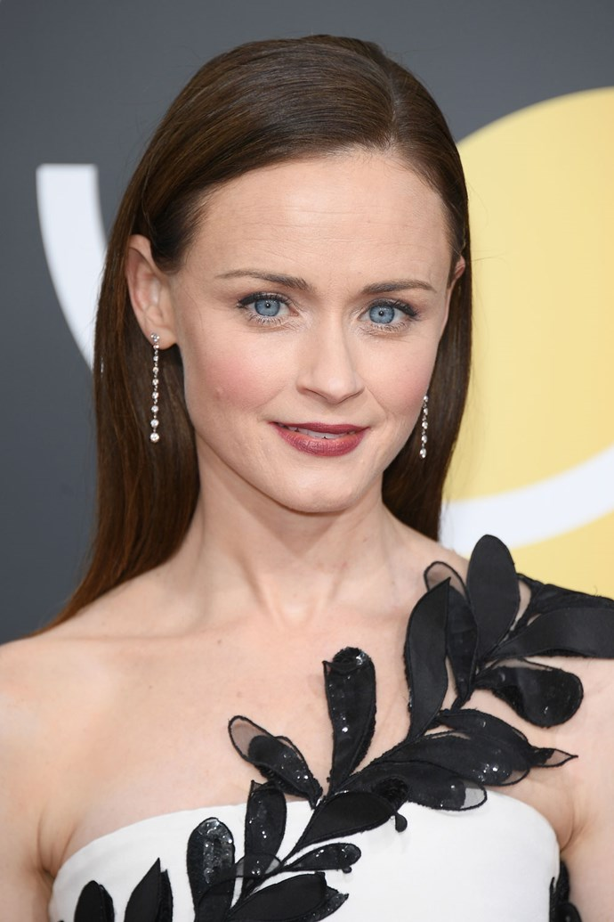 **Alexis Bledel** <br><br> Alexis Bledel knows as well as we do that the only makeup IRL Rory needs is a swipe of wine-colour lipstick and a pop of blush.