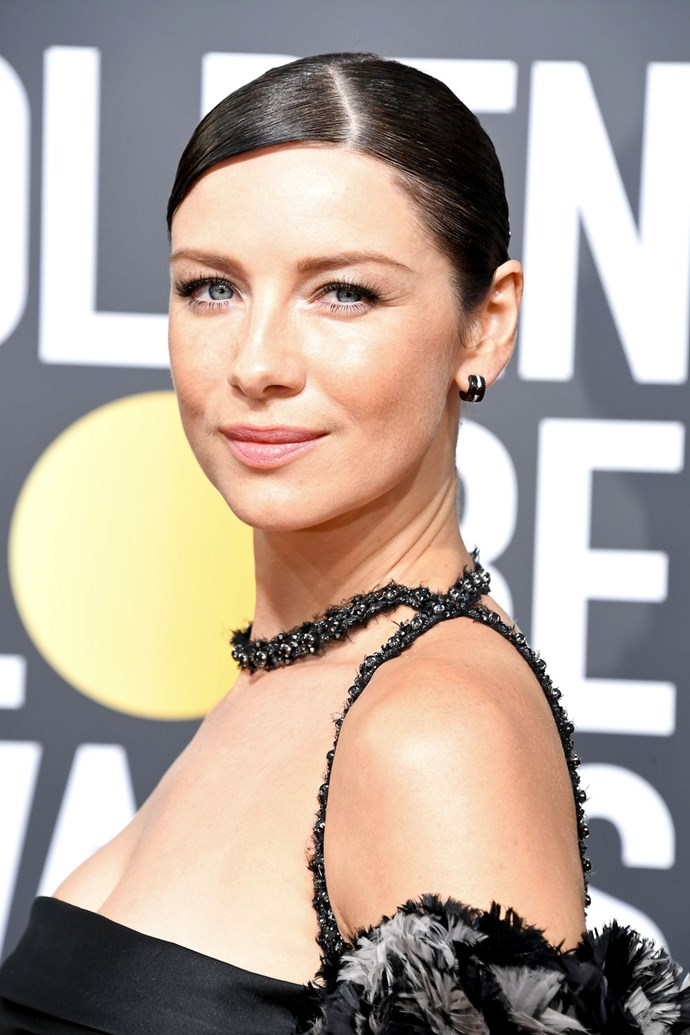 **Caitriona Balfe** <br><br> The *Outlander* actress kept her beauty look simple, rocking a sleek, asymmetrical updo and minimal makeup.