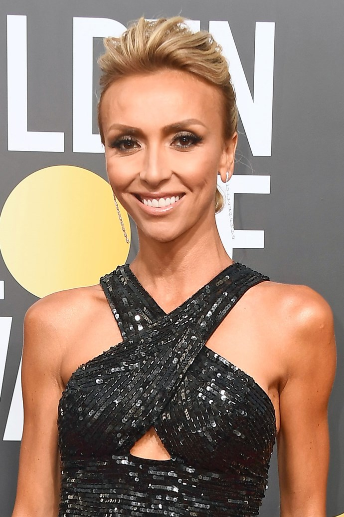 **Giuliana Rancic** <br><br> The queen of red carpets could never let us down. Giuliana has paired mega bronzed skin with a dark smokey eye, nude lips and a messy plait.