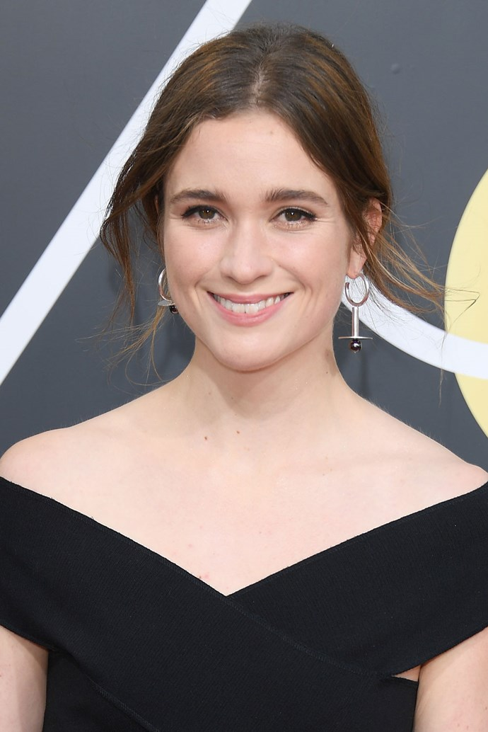 **Alice Englert** <br><br> The *Top of the Lake* actress kept her beauty look super casual for this year's red carpet, pulling a few strands out of her updo and keeping her makeup to a minimum.