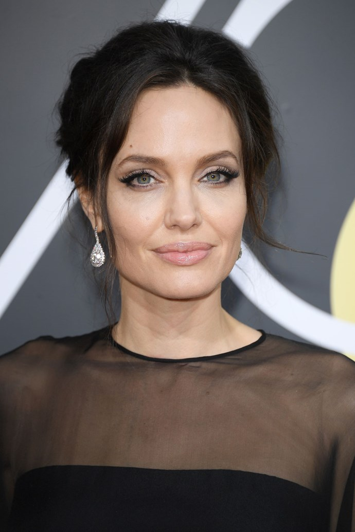 When does Angelina Jolie not slay?! The actress opted for a retro updo and a winged eye.