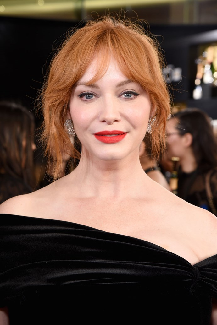 **Christina Hendricks** <br><br> Christina Hendricks knows that the best thing to pair with bright red hair is an even brighter red lip.