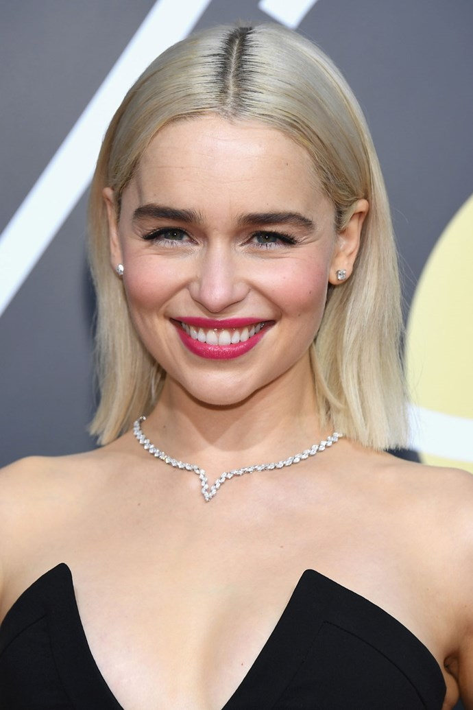 **Emilia Clarke** <br><br> The Mother of Dragons rocked her new peroxide locks on this year's Golden Globes Red Carpet. And what better to pair with bright blonde hair than a fushia lip?!