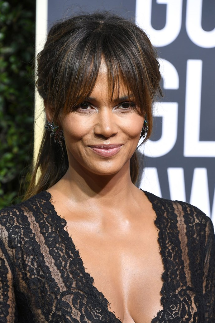 **Halle Berry** <br><br> Even though you may think that a half-up-half-down do isn't exactly 'red carpet', Halle proves as all wrong by rocking the style with whispy bangs.