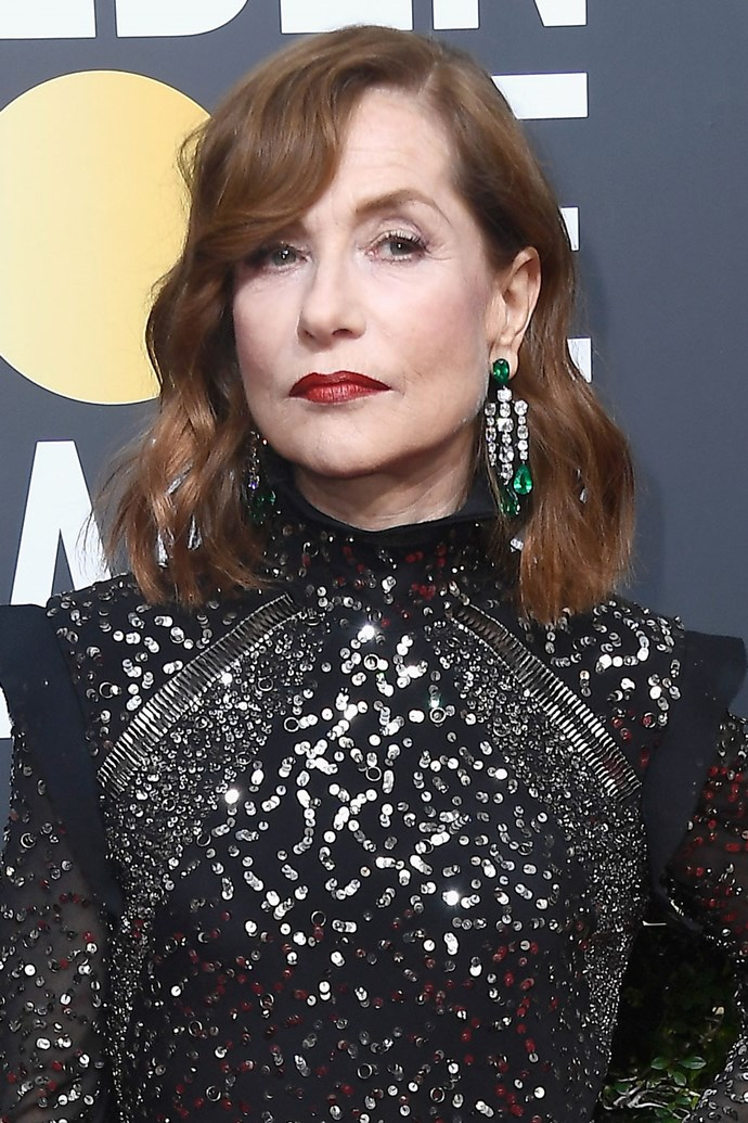 **Isabelle Huppert** <br><br> We are sickkk for this shiny red lip.