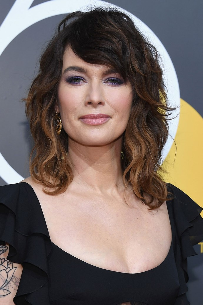 **Lena Headey** <br><br> Lena Headey stays true to her edgy look with a deep-parted side fringe and a super-smokey purple eye.